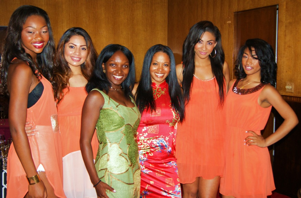 Shikiri and China Royal Chief Operating Officer Keonnis Taylor-Flores backstage with the models before the show.